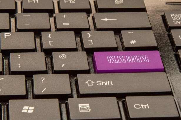 button on a keyboard that says 'online booking'