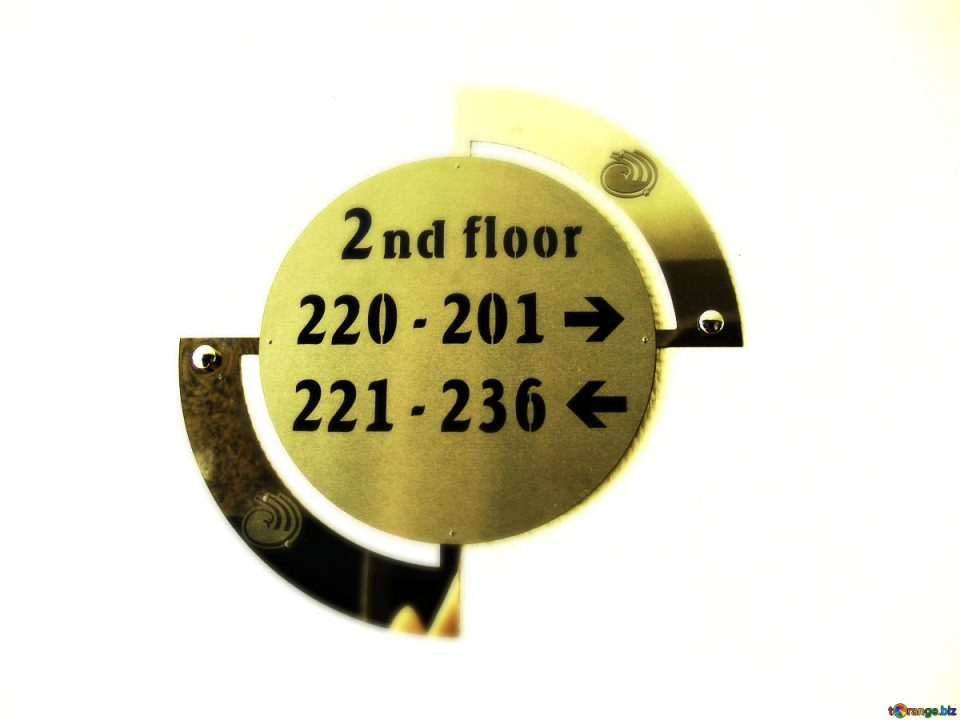 Sign displaying room numbers in a hotel.